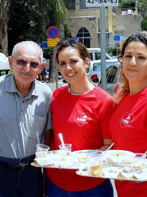 "Employees of the ""Strauss Group"" prepare a pampering healthy breakfast for Holocaust survivors"
